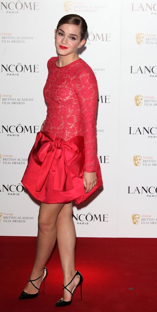 Emma Watson matched her lipstick to her dress.