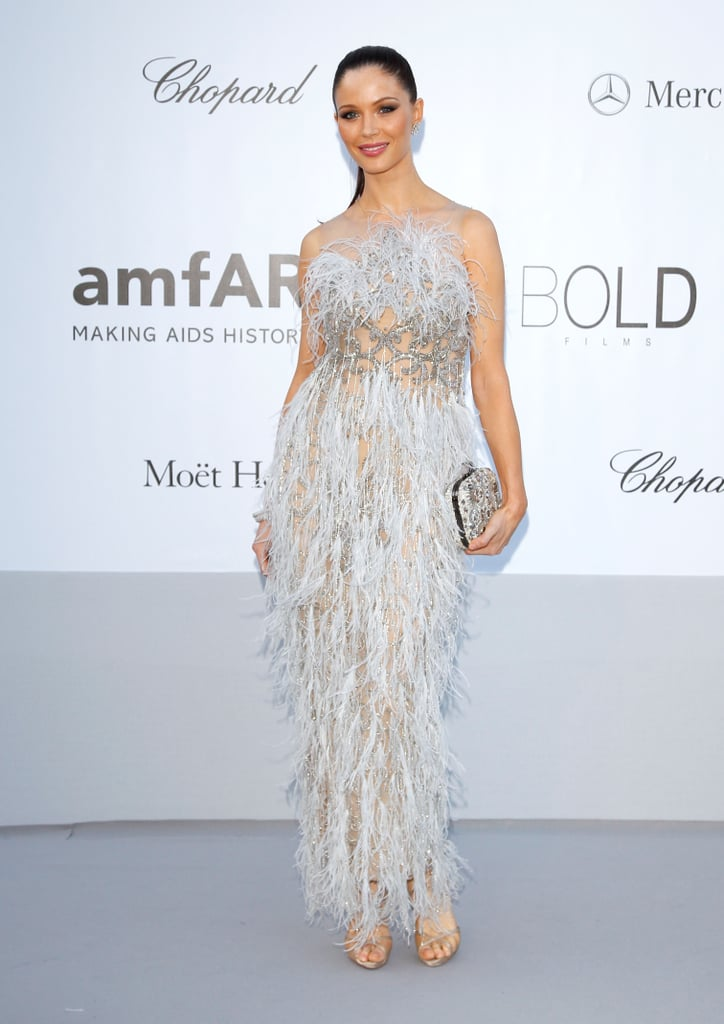 Georgina Chapman showed off her evening glam via a beautiful floor-length feathered creation.