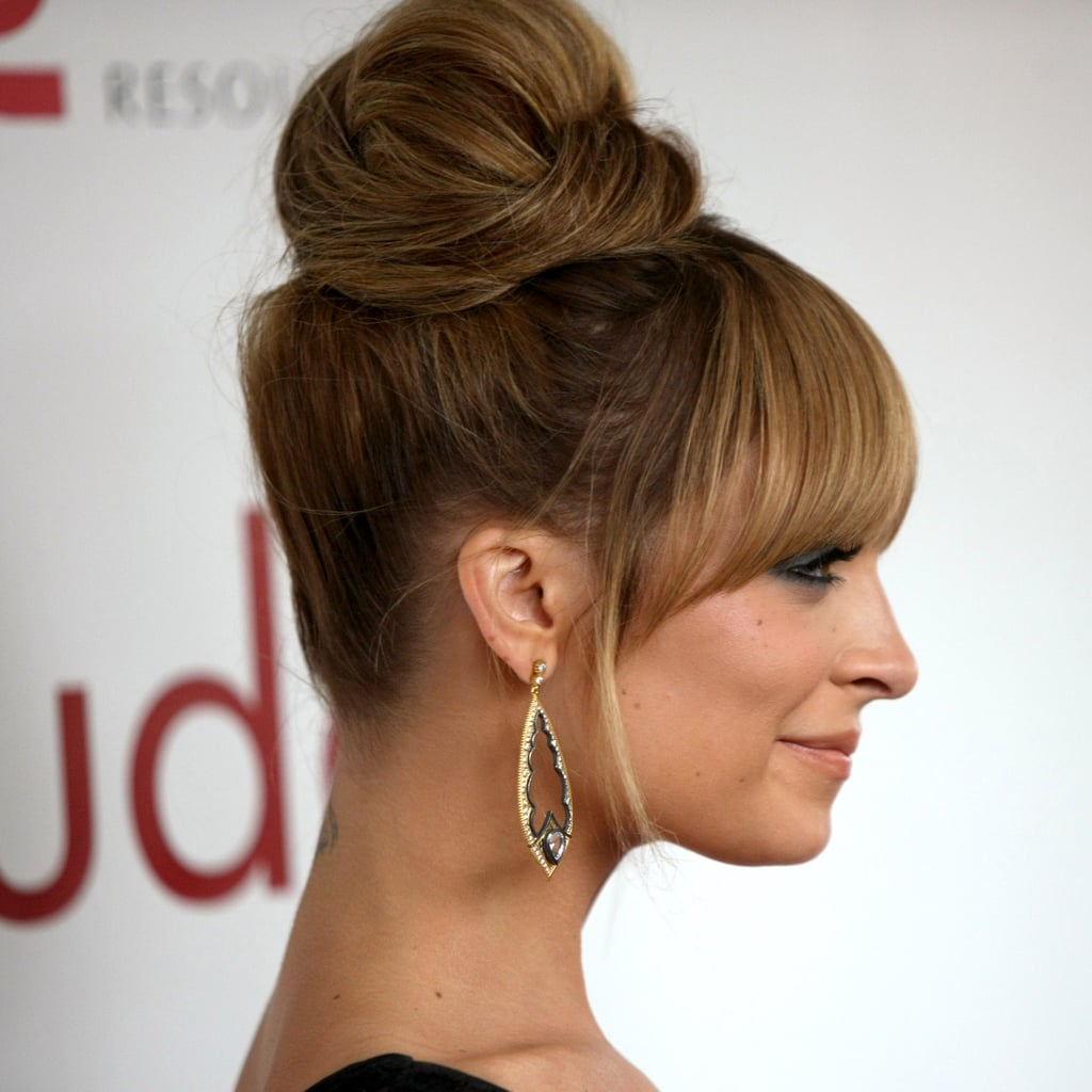 This updo starts with an ultrahigh ponytail (think high-school cheerleader high).