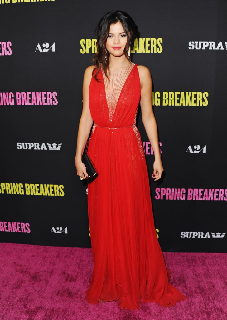 Selena Gomez stunned in a red Reem Acra Spring '13 gown — which appealed to her sexy skin-baring ways via delicate beaded illusion panels — at the LA premiere of Spring Breakers. Then, she paired the look with a black Jimmy Choo clutch and Lorraine Schwartz jewels.