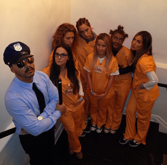 Derek Hough shared a snap of his sister, Julianne Hough, with a group dressed up as the characters from Orange Is the New Black. The photo has since been taken down, and Julianne apologized via Twitter for her controversial costume choice. Source: Instagram user derekhough