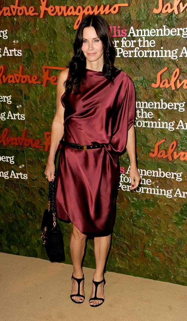 Courteney Cox wore a maroon Greek-inspired gown to the Annenberg Gala.