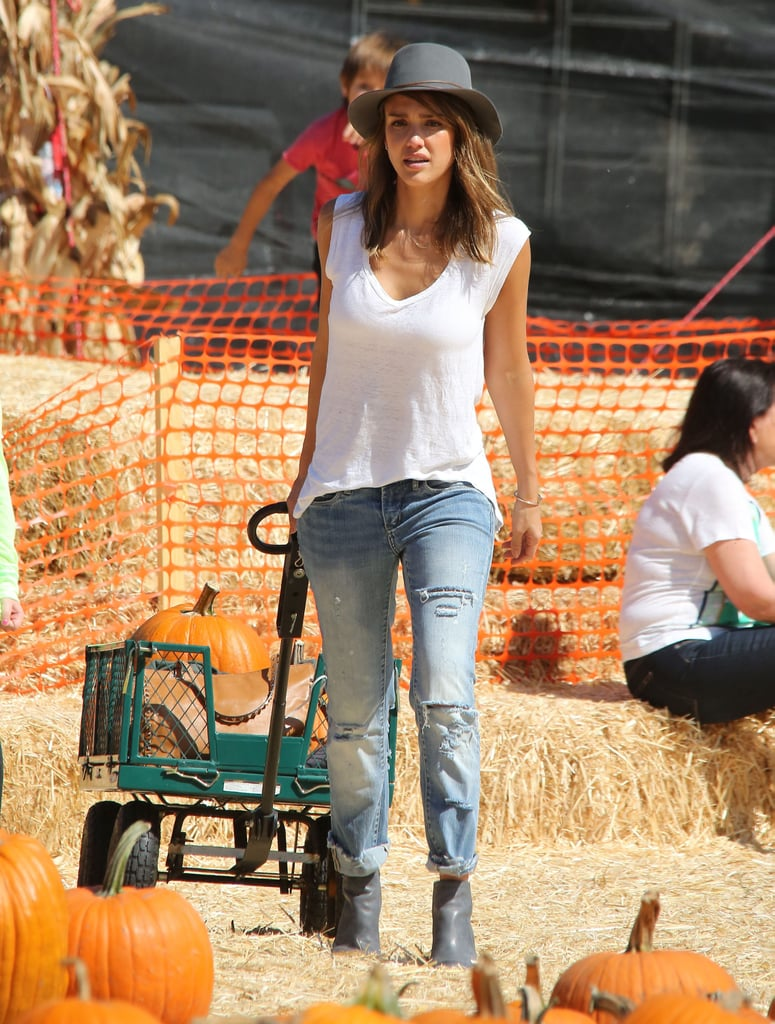 Jessica Alba carted a bunch of pumpkins through a patch in LA.