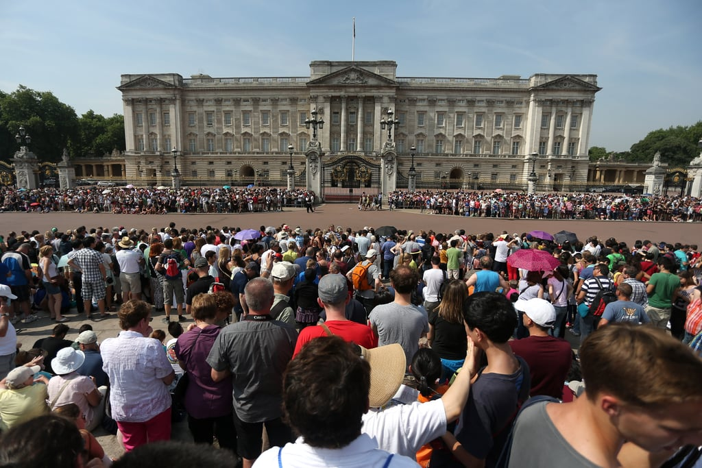 Crowds gathered to see the royal baby's birth announcement on an easel outside Buckingham Palace.