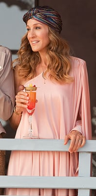 Carrie Bradshaw in Peach Halston Dress in Sex and the City 2