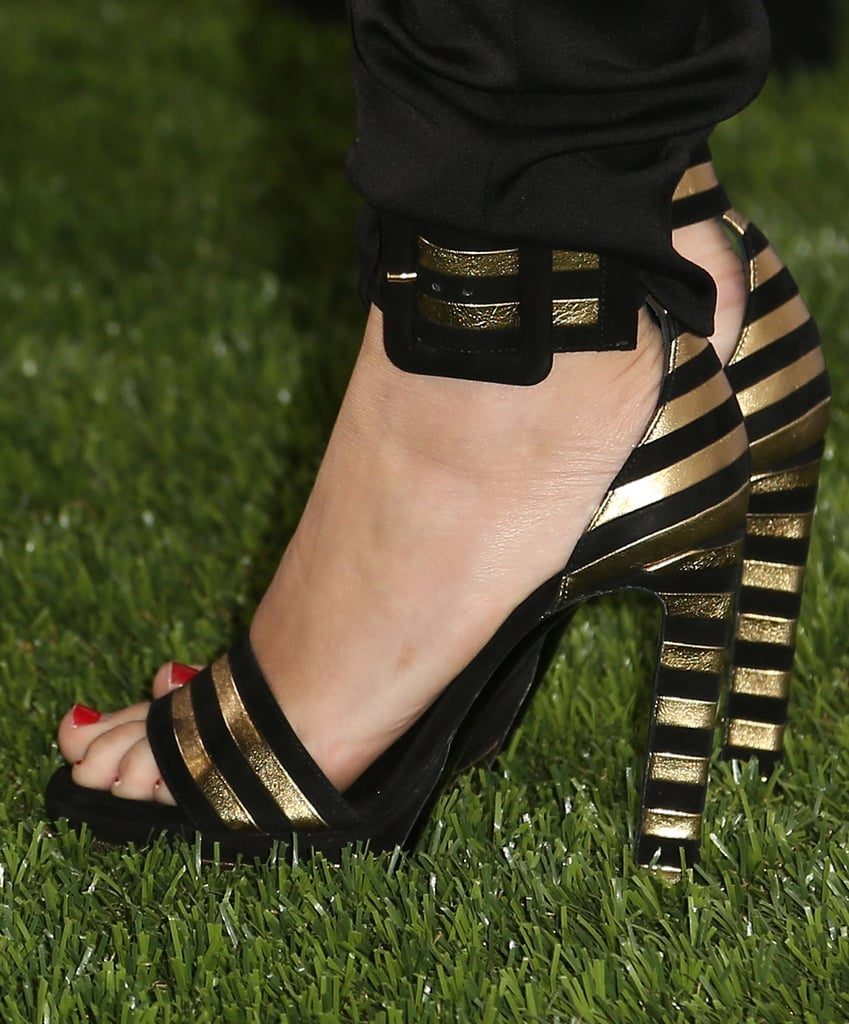 To accept her Maxim honor this Summer, Miley Cyrus picked black-and-gold striped sandals.