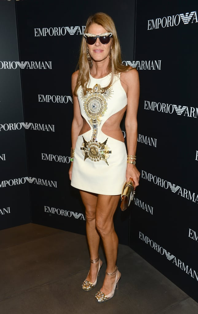 Anna Dello Russo bared some of her midriff — and poured on the golden glitz, too — at the Emporio Armani flagship opening.