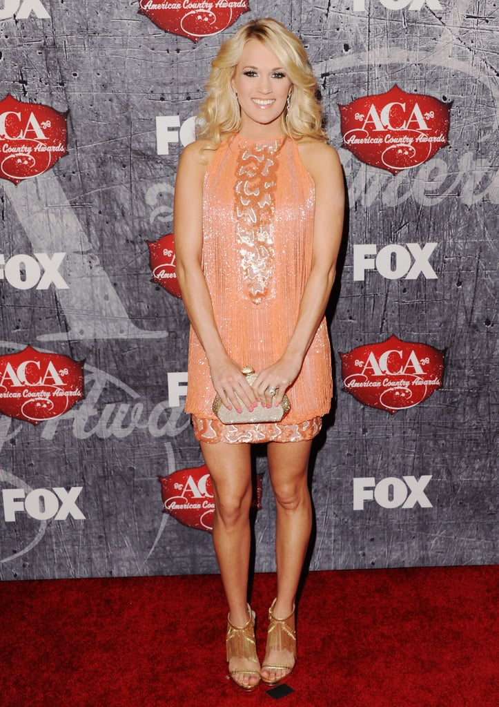 For the 2012 American Country Awards, Carrie Underwood doubled up on fringe in a swinging sherbet-colored mini and metallic B Brian Atwood sandals.