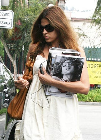 Eva Mendes Keeps Her Headphones in and Her Hands Free