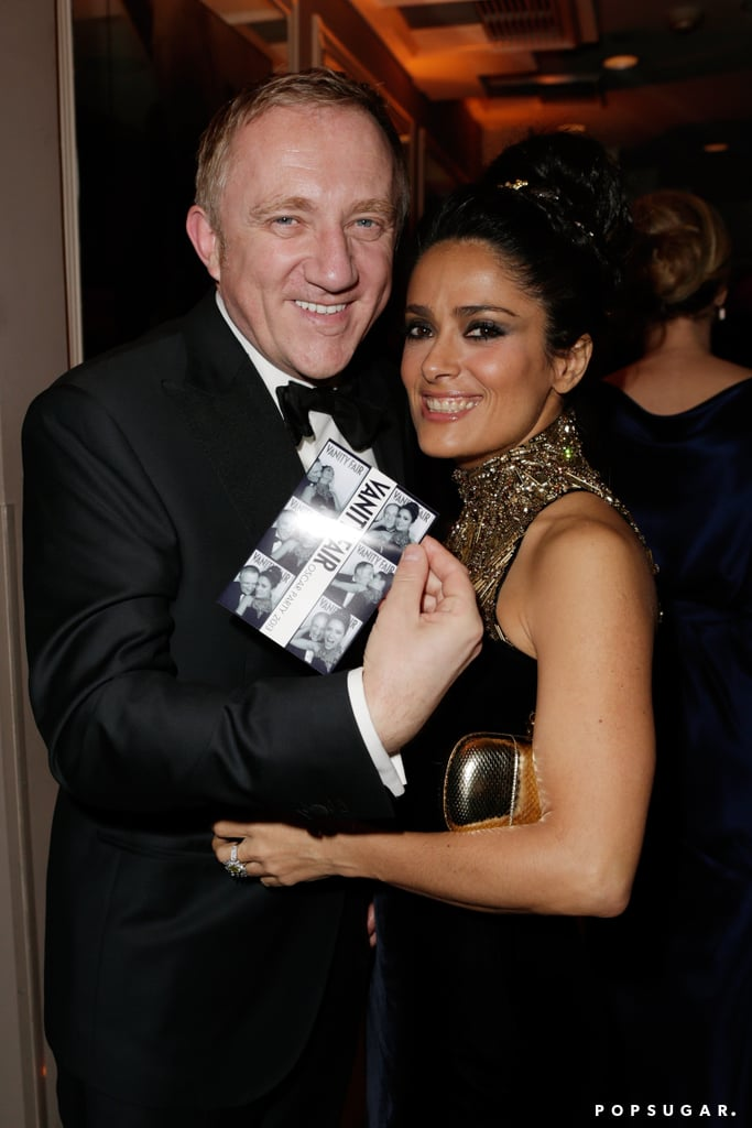 Francois-Henri Pinault and Salma Hayek showed off their photo-booth pictures at the Vanity Fair Oscar party on Sunday.