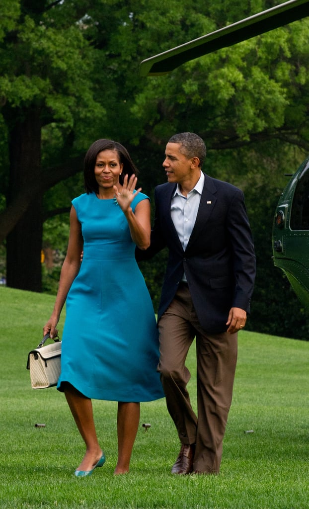 We love how this bold, blue sheath dress looked on Michelle; the color popped against her skin, and she smartly adorned it with an Erickson Beamon brooch.