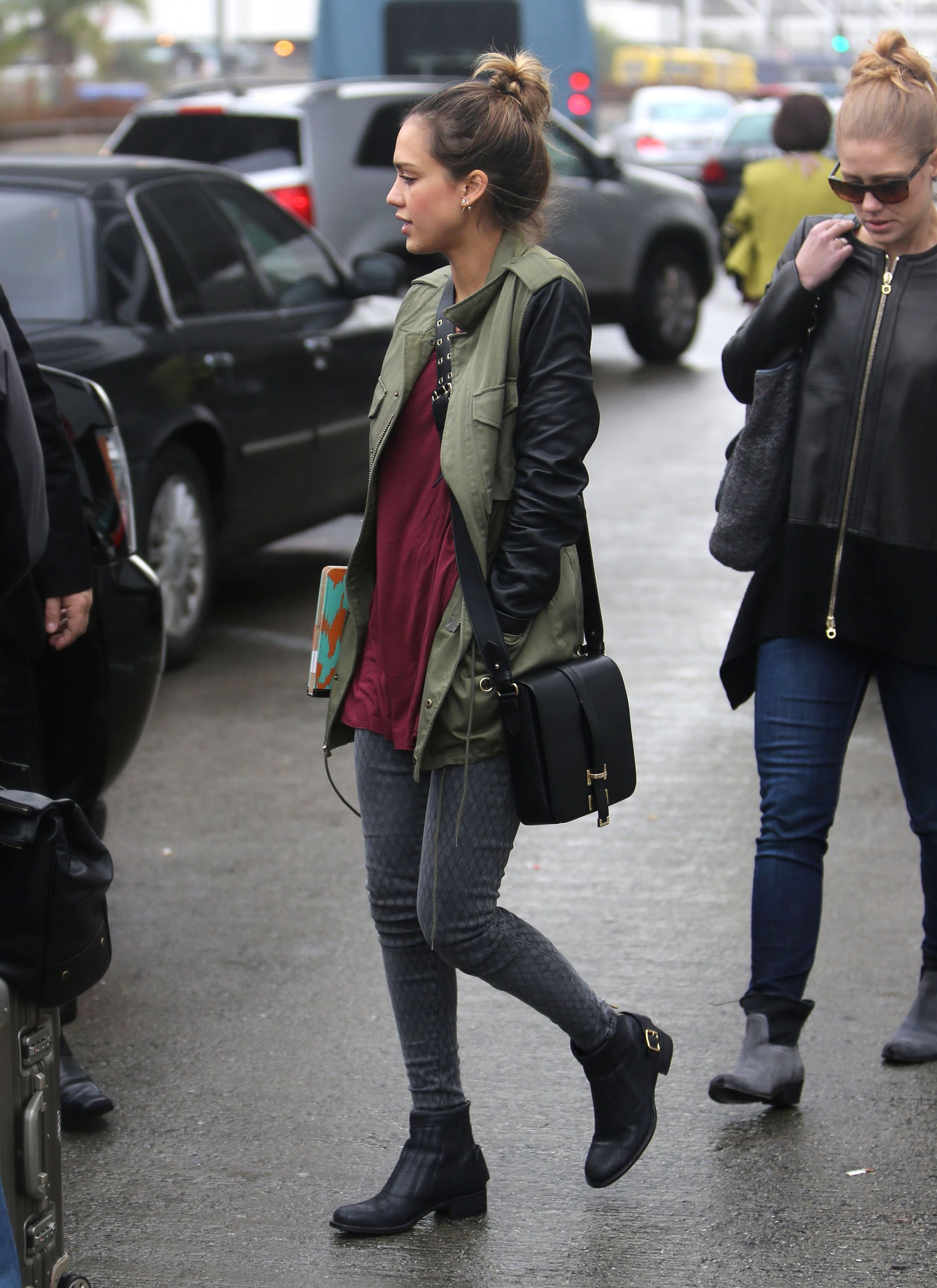 Even a rainy day can't damper Jessica's killer style. The model mom bundled up in a leather-sleeved military jacket by Sanctuary, fishnet-print Current/Elliott denim, and leather Rupert Sanderson ankle boots.