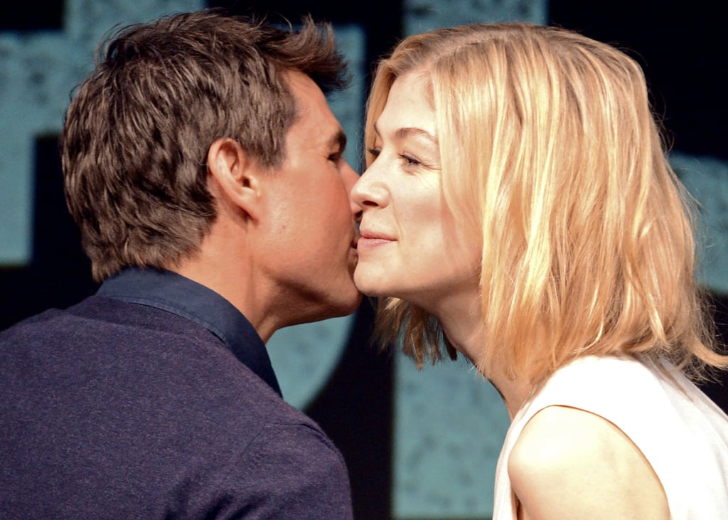 Tom Cruise greeted Rosamund Pike with a kiss.
