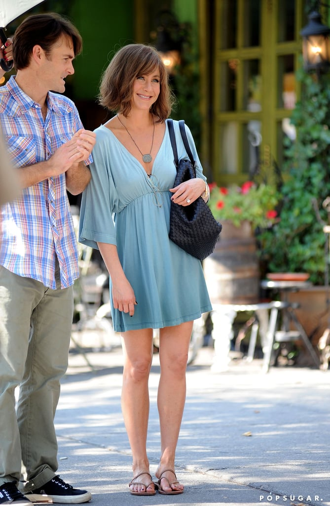Jennifer Aniston flashed a smile on July 17 while filming a scene.