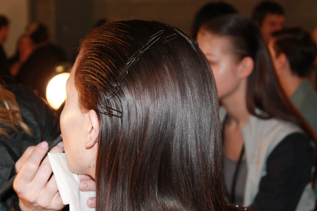 Pins were placed from ear to ear to keep the hair flat and removed before models hit the runway. Photo: Maria Del Russo