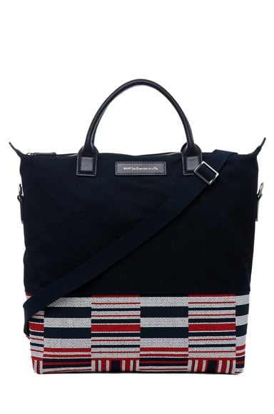 I've had the same old computer bag for years simply because I couldn't find anything that appealed to me, until I saw this Want Les Essentials De La Vie O'Hare shopper tote ($350). It's roomy enough for work essentials and built for comfort with two different strap options. Plus, the print adds just the right amount of flavor.  — Meg Cuna