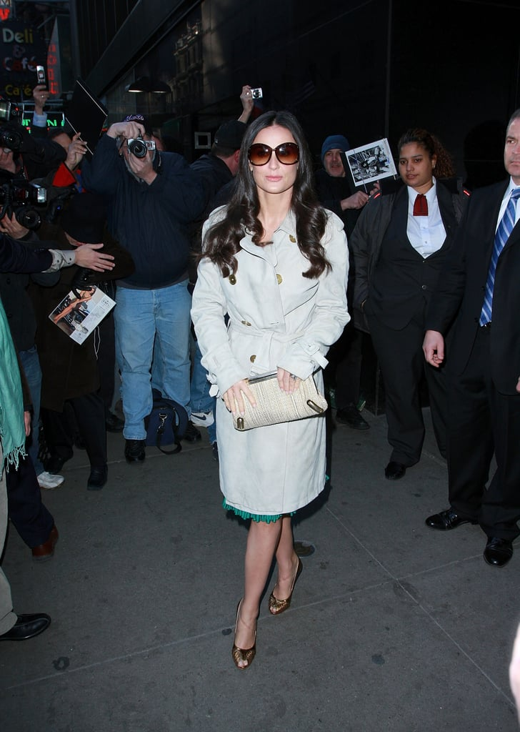 Making a TV appearance in a classic trench and oversize sunnies in NYC.