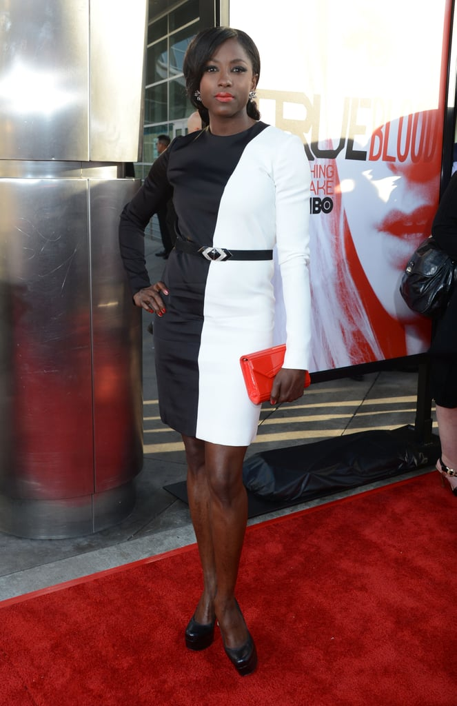 Rutina Wesley matched her lip color to her clutch at the premiere.