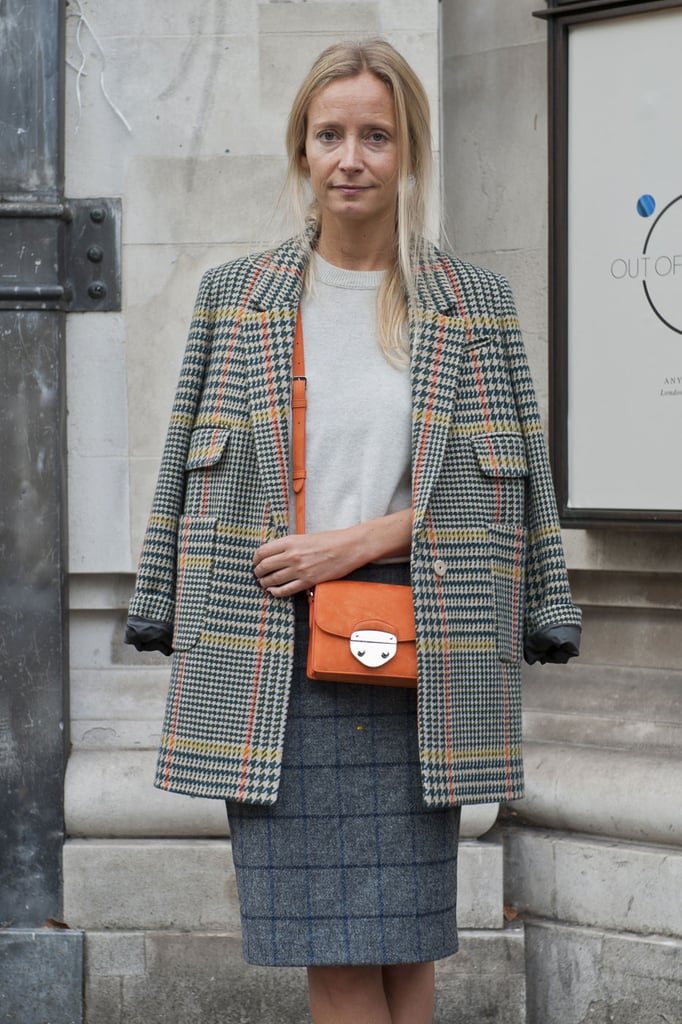 She makes the orange print pop with a matching cross-body bag.