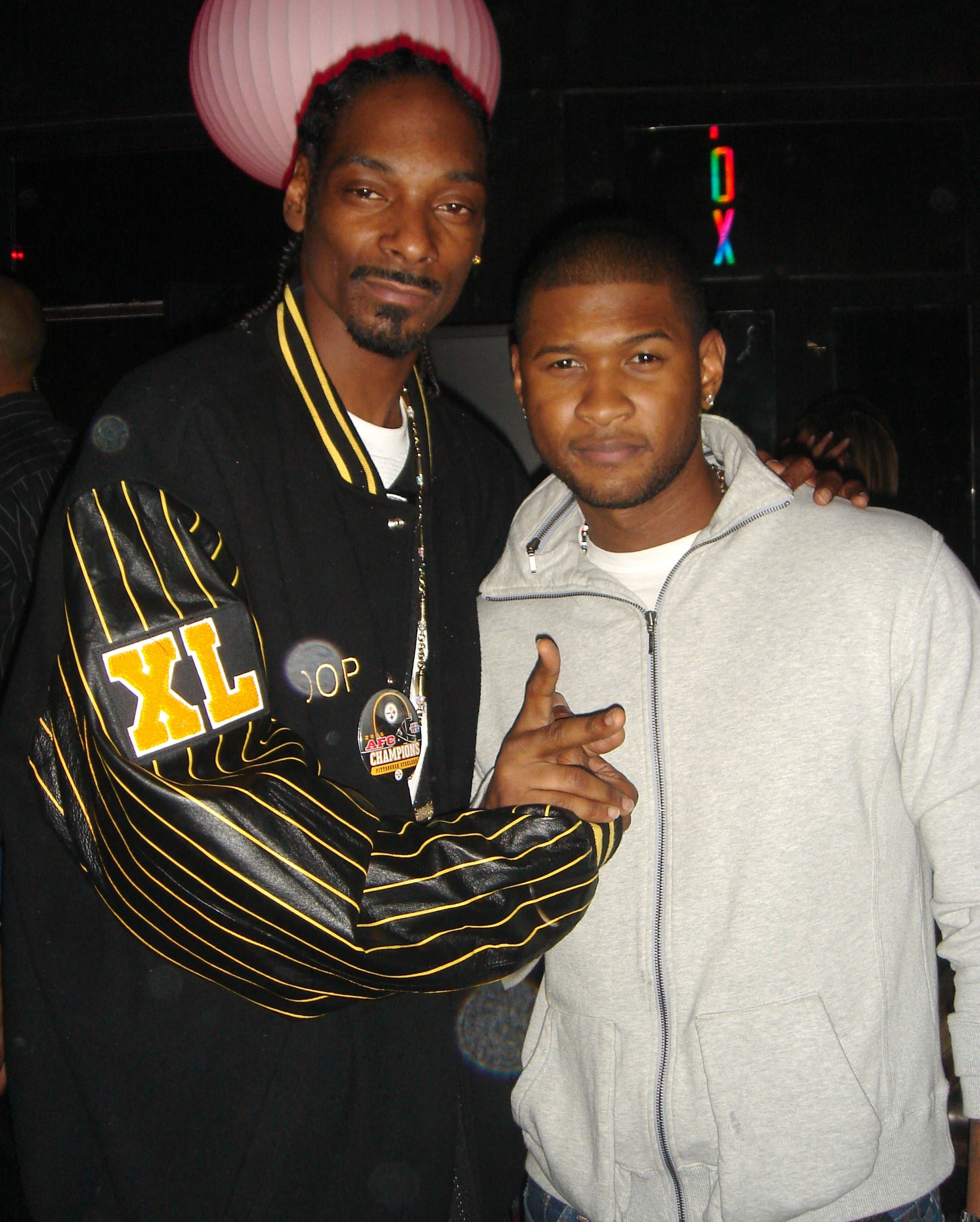 Snoop Dogg and Usher posed for pictures at the ESPN Late Night party in 2006.
