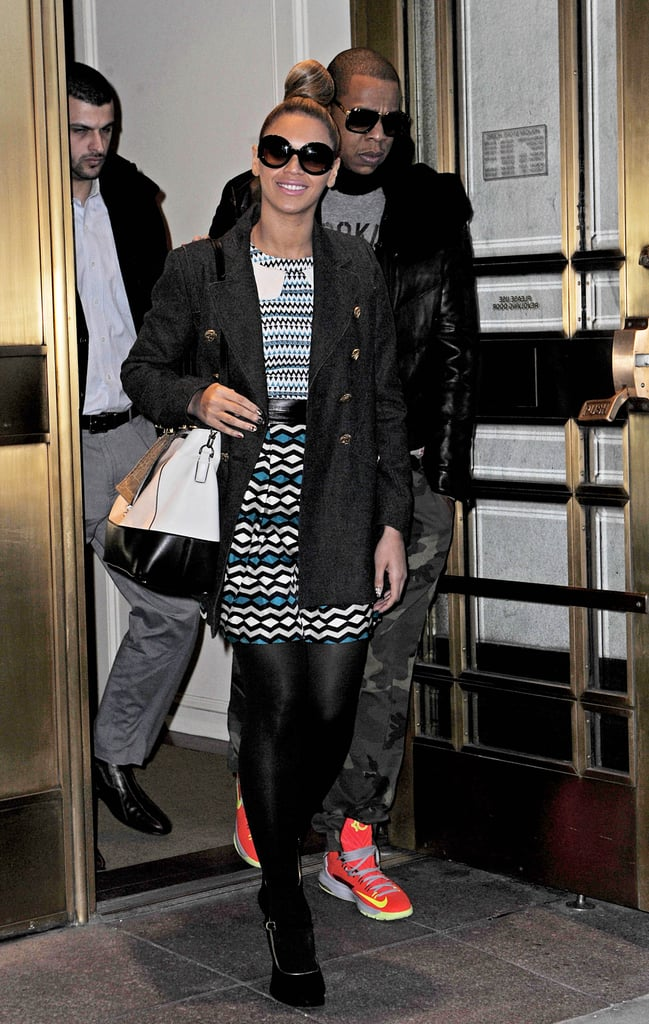 Beyoncé proved to be a print master in a Milly dress while Jay Z stood out in camouflage pants and fluorescent Nike sneakers in December 2012.