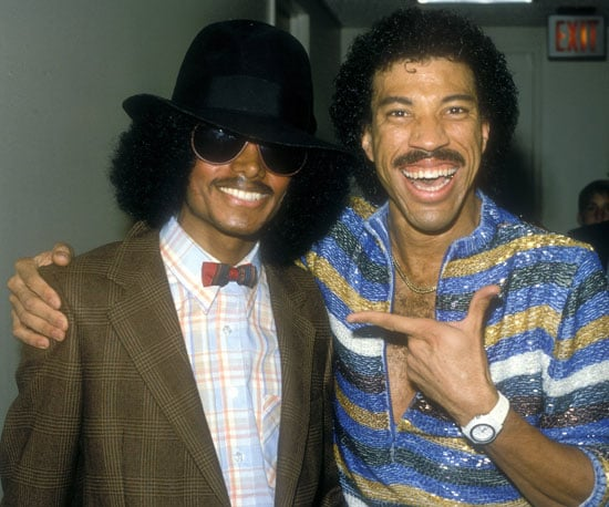 Michael, who is Nicole Richie's godfather, posed with her dad, Lionel, in 1980.