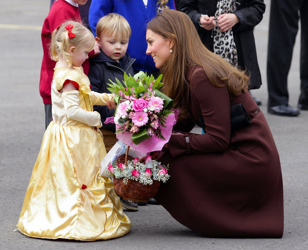 Kate Middleton chatted with a girl in a princess costume on March 5 when she toured the town of Grimsby in England.