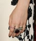 Zosia Mamet's dress may have been black and white, but she added color with a sparkly set of rings.