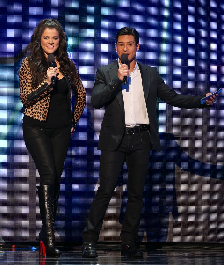Hosts Khloé Kardashian and Mario Lopez walked on the stage.