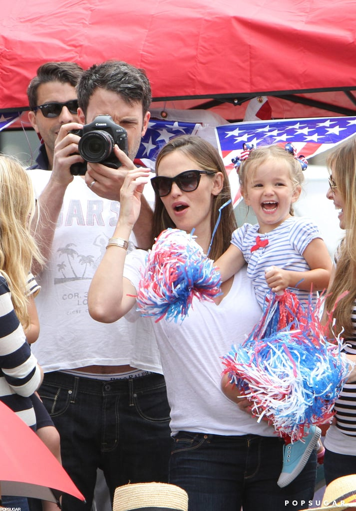 The Garner-Afflecks celebrated the Fourth of July at a holiday parade near their Brentwood, CA, home.