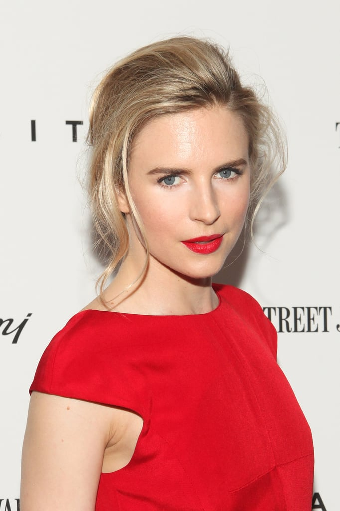 Brit Marling paired her red dress with bright red lips.