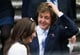 Nancy Shevell and Paul McCartney wiped flower petals off of their heads after their wedding.