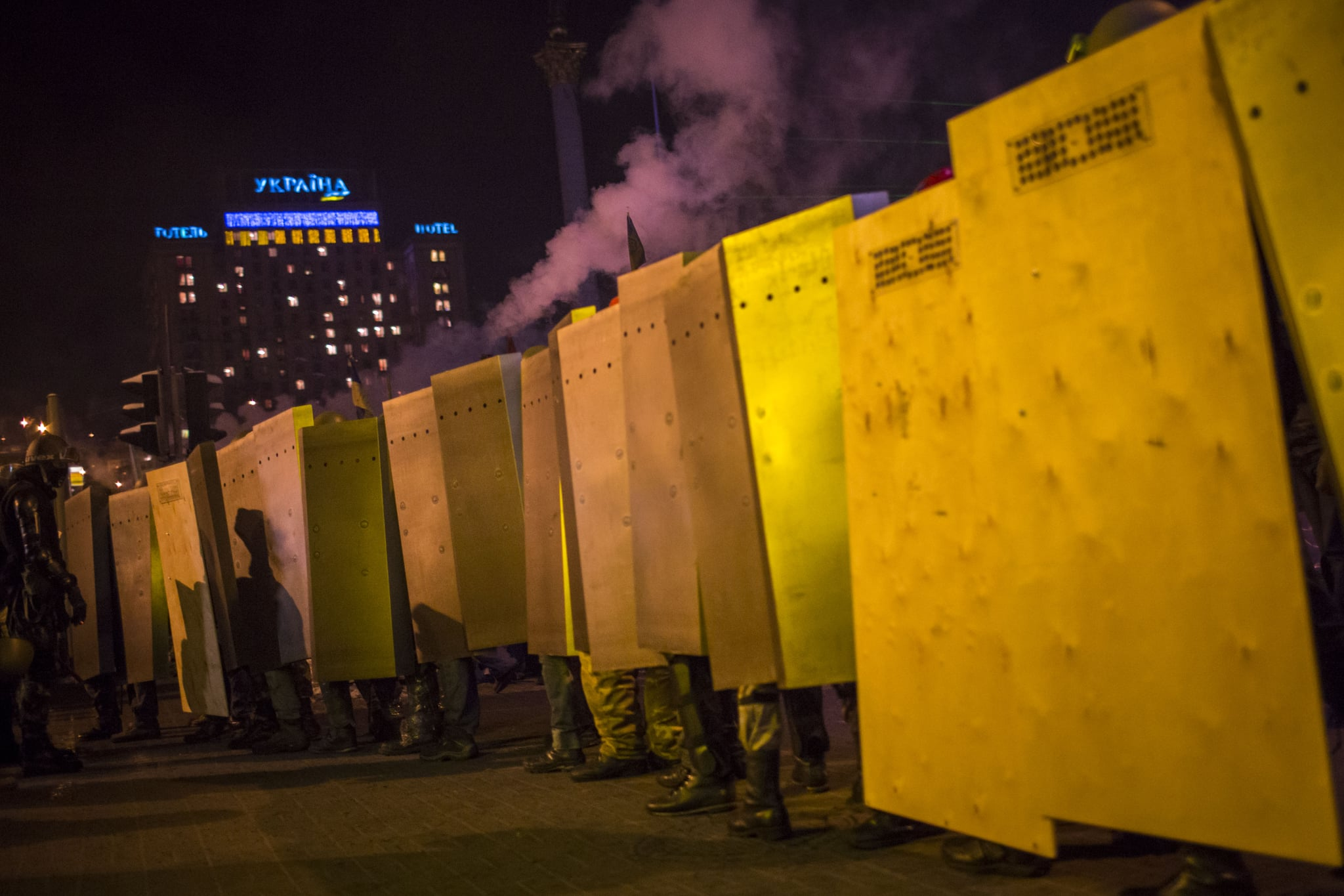 Protesters carried metal shields to march through Kiev.