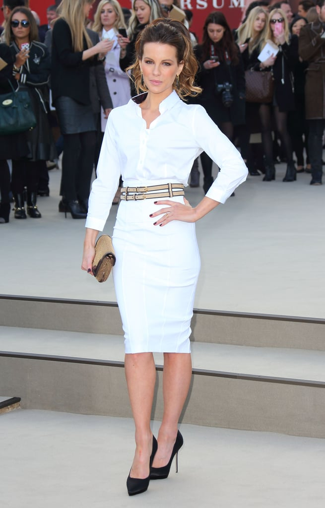 Kate Beckinsale was undeniably fresh in all-white at Burberry Prorsum. She let her accessories do the work with satin black pumps, a nude double belt, and a gold studded clutch.