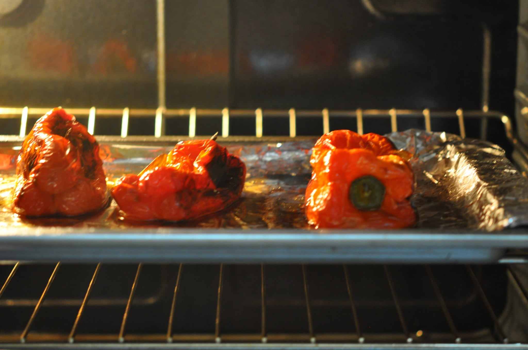 Be sure to watch them closely. Every 10 to 15 minutes, flip the bell peppers so each side of the pepper is charred.