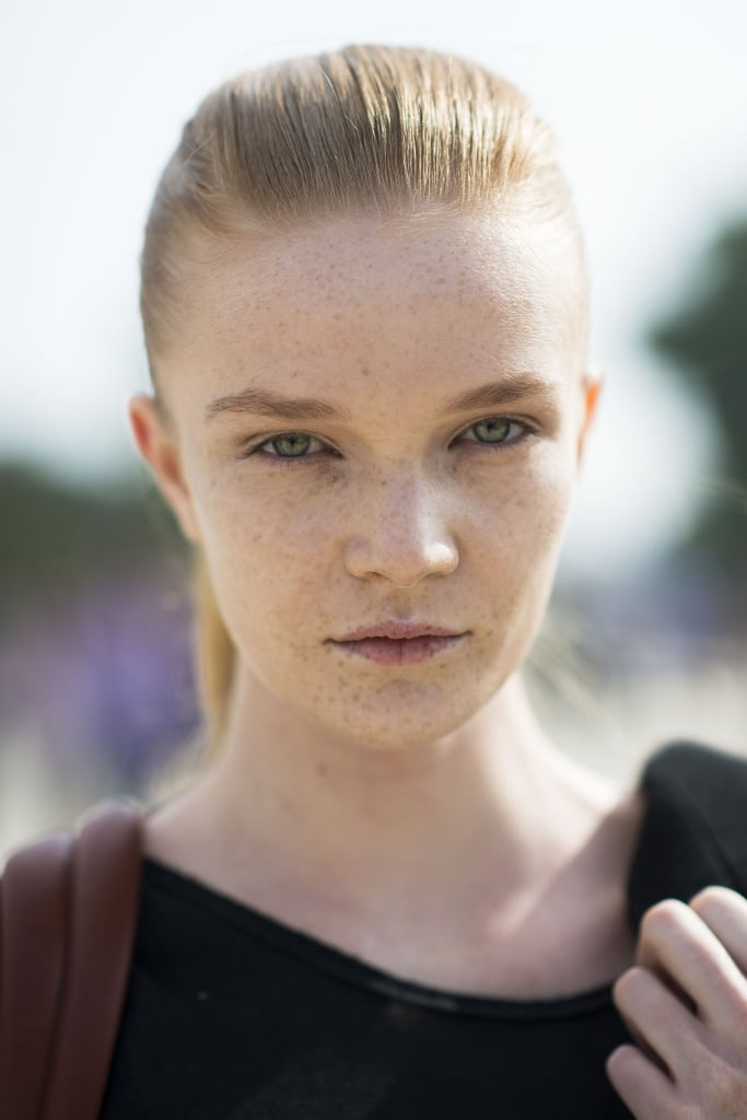 The best way to show off freckles? With a slicked-back ponytail, of course. Source: Le 21ème | Adam Katz Sinding