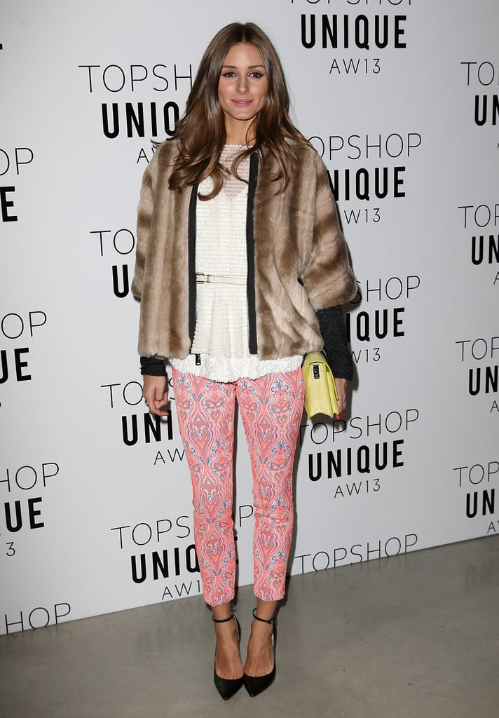 Olivia Palermo's pink print pants brought feminine flavor to her white top and furry coat at Topshop Unique.