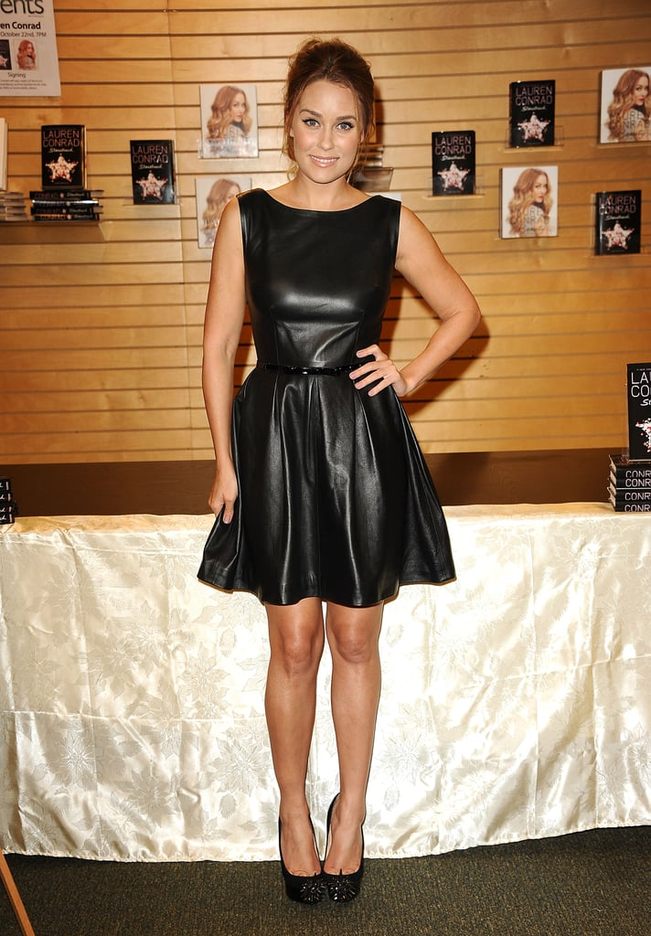 Lauren Conrad always nails the sweet-but-sexy look, and her pleated leather Johanna Johnson dress was just that. Lauren loaded up her ensemble with a few contradictory touches: while she started with a cutesy Kate Spade New York bow belt, she also added a pair of fierce, spiky Christian Louboutin heels.