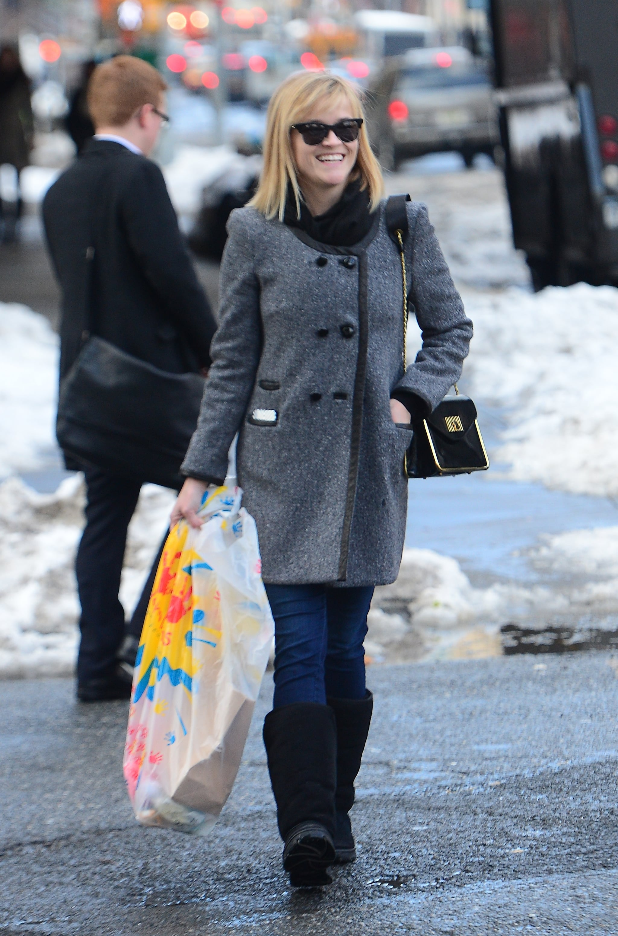 While visiting NYC, Reese bundled up in a tweed coat and black shearling boots.