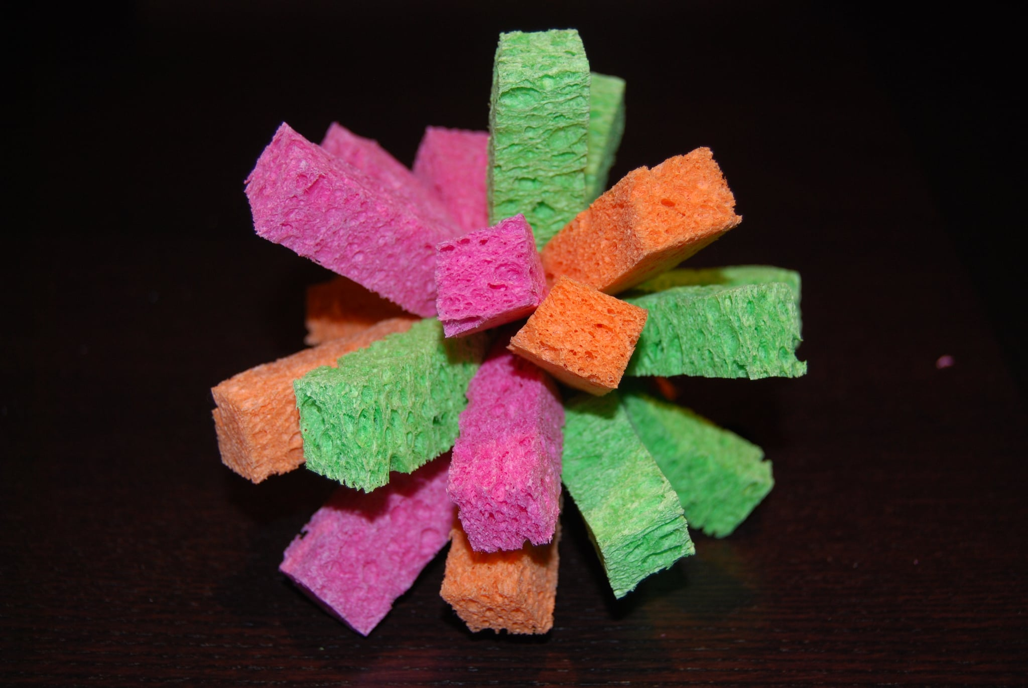 Added four orange pieces to eight pink and green sponge pieces to create a fuller sponge ball.