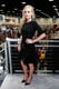 Anna Paquin signed autographs for fans of her show, True Blood, in a black top and a shiny black trumpet skirt.
