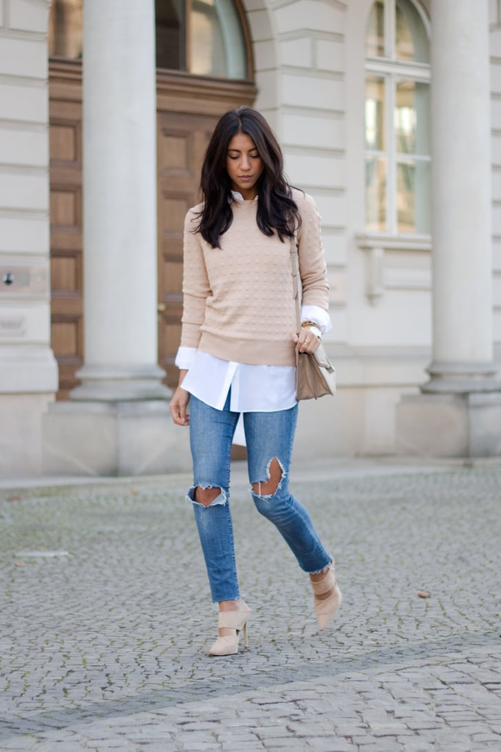 A blush sweater layered over a white shirt jeans and for Matching denim shirt and jeans