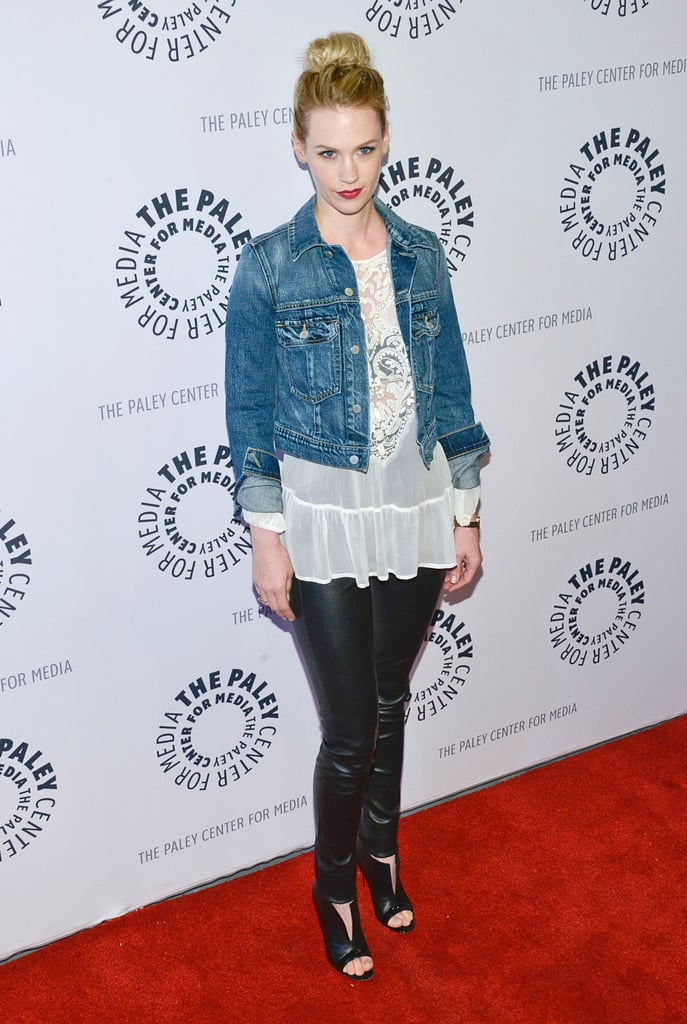 January Jones took a casual red carpet approach in a cropped denim jacket, which she wore over a white sheer blouse, black leather pants, and black peep-toe booties.