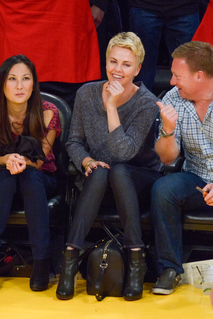 Charlize Theron chuckled with friends at an LA Lakers game in April.