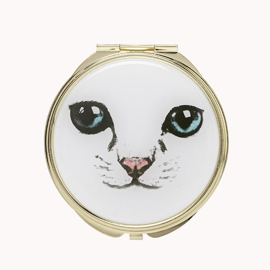 There's something timeless and feminine about touching up your makeup with a cute pocket mirror. This Feline Mirror Compact ($4) will have your kitty-loving friend excited to stow this in her bag.