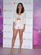 Selena dared to bare her midriff in a whimsical Versace two-piece getup from the Spring 2012 line, complete with nude Giuseppe Zanotti pumps, at her fragrance launch in NYC.