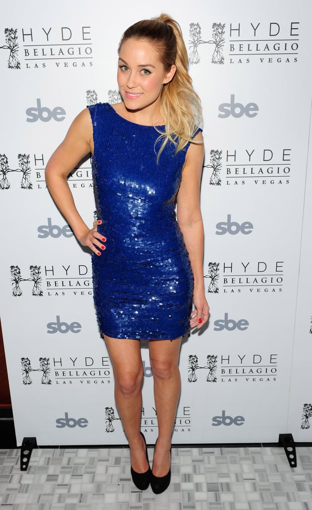 Lauren celebrated her 26th birthday in a bold blue sequined Alice + Olivia dress in 2012. Lesson from Lauren: you'll be dance floor ready at any party with a sky-high ponytail.