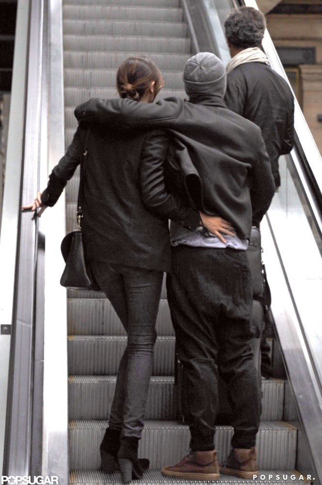 Orlando Bloom and Miranda Kerr shared a hug catching a train out of Paris in October 2010.