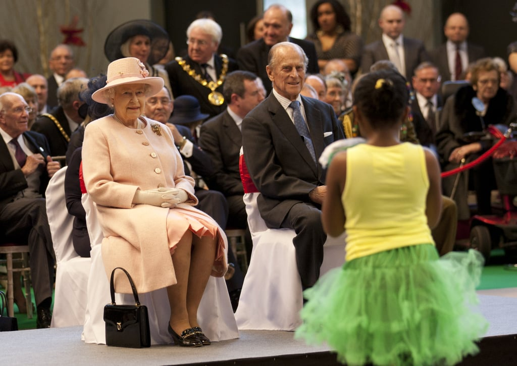 Queen Elizabeth II and Prince Philip watched performers during a visit to the Manchester Central Convention Centre.