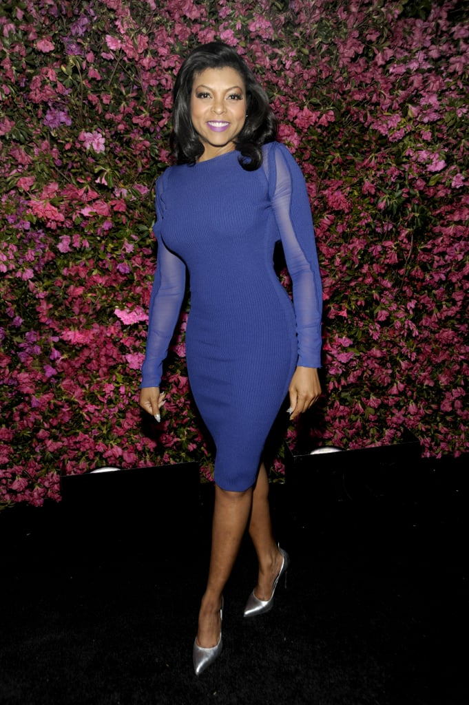 Taraji P. Henson showed off her curvaceous figure in a formfitting sheer blue Stella & Jamie dress, then added a bit of shine via silver metallic pumps.